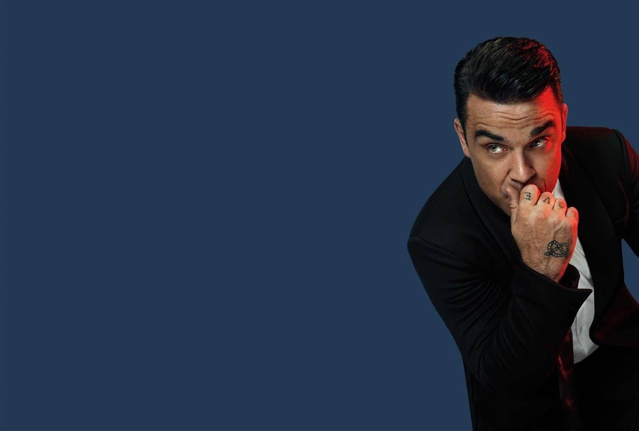 TOP 10 nejlepších písní Robbieho Williamse ušima dvou redaktorů