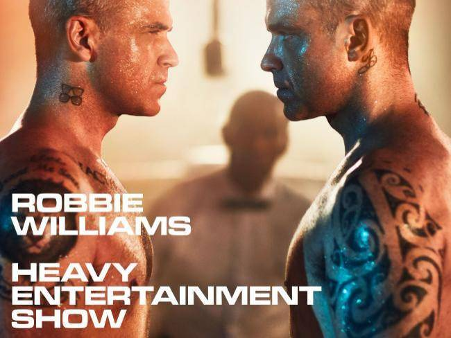VIDEO: Robbie Williams ohlašuje nové album, pomáhali mu i Ed Sheeran nebo Brandon Flowers